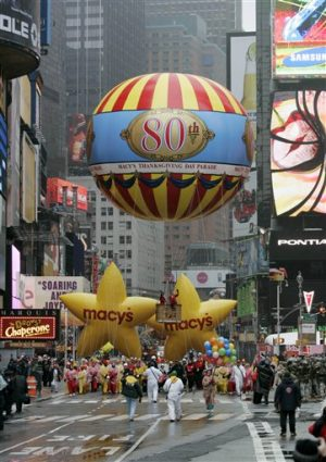 The first balloon for the Macy's Thanksgiving Day parade moves through Times Square Thursday, Nov. 23, 2006 in New York. (AP Photo/Frank Franklin II)
