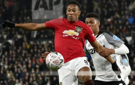 Manchester United Forward Anthony Martial fights for the ball against Derby's Morgan Whittaker during the fifth round of the FA Cup at Pride Park in Derby, England.  Manchester United would go on to win the match 3-0.