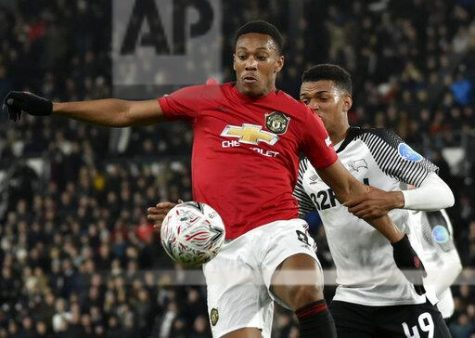 Manchester United Forward Anthony Martial fights for the ball against Derby