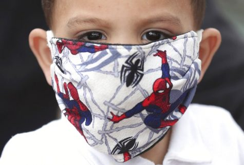 A boy wears a Spiderman face mask amid the spread of the new coronavirus in Bogota, Colombia, Thursday, April 30, 2020. (AP Photo/Fernando Vergara)