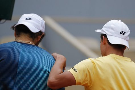 Germany's Daniel Altmaier comforts Italy's Matteo Berrettini, left, after winning his third round match of the French Open tennis tournament in three sets, 6-2, 7-6 (7-5), 6-4, at the Roland Garros stadium in Paris, France, Saturday, Oct. 3, 2020. (AP Photo/Christophe Ena)