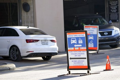 Cars enter and leave a drive-thru voting site on Election Day, Tuesday, Nov. 3, 2020, in Houston. (AP Photo/David J. Phillip)
