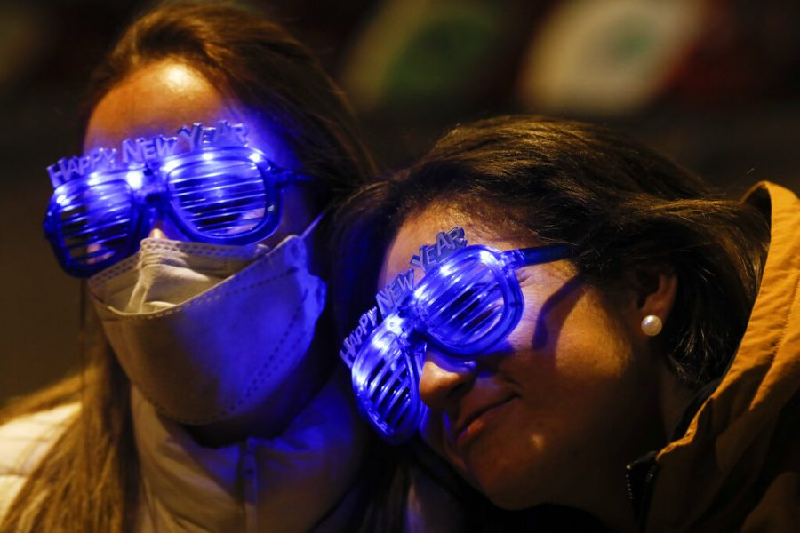 Guatemalan tourists Alejandra Paiz, left, and Argelia Gordillo wear festive glasses as the pair and their sons mark New Year